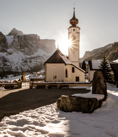 winter dolomites church sunset