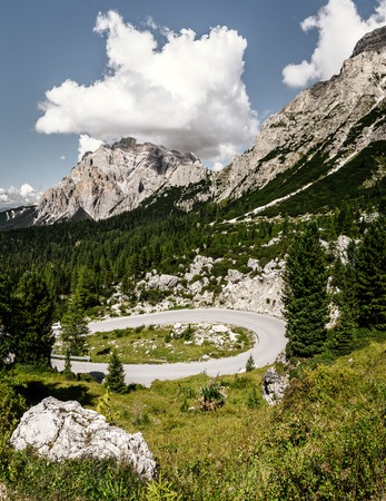 alta badia pass road driving bend dolomites Stock Photo