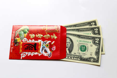 envelop: Red envelop and Lucky money. Red envelopespackets are money wrapped in red paper given to kids from their parents, grandparents and others as New Year gifts. Stock Photo
