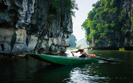 Riding long river through 3 tunnel cave, Tam Coc, Nin Binh Province, Vietnam