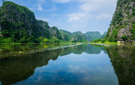 Limestone cliffs  Tam Coc Grotto, Ninh Binh Province, Vietnam photo