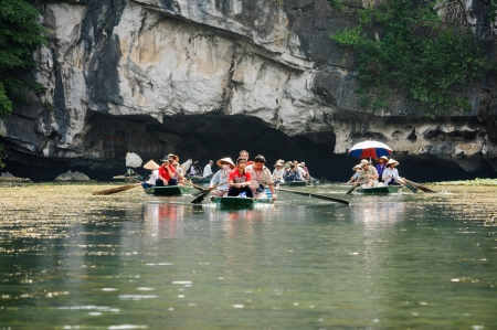 PHAT DIEM TOWN, NINH BINH, VIETNAM - SEPTEMBER 30  Unidentified tourists in Tam Coc Grotto on Steptember 30, 2009  Tam Coc is also called A terrestrial Ha Long Bay  Editorial