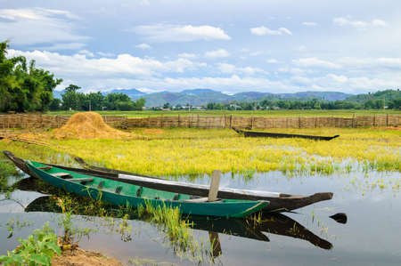 Two wooden boats are anchored, golden hours on the Lak lake, Daklak province, Vietnam Stock Photo
