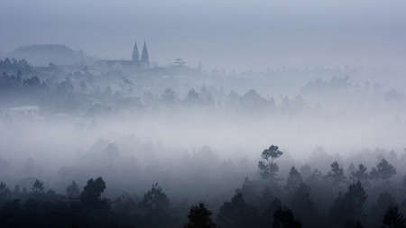 loc: Thanh Xa Church and forest in morning mist  Bao Loc, Lam Dong Province, Vietnam