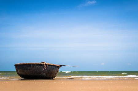 Woven bamboo basket boat on seaside  Phuoc Hai Fishing Wharf, Vung Tau Province, Vietnam photo
