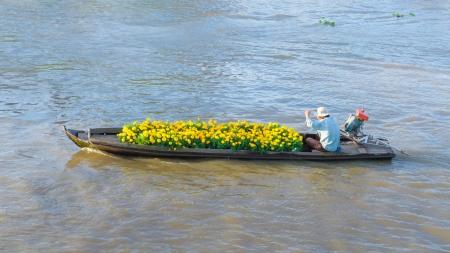 Man with flowers boat, Soc Trang, Mekong Delta, Vietnam