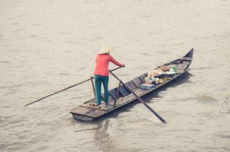 Woman and food stall boat in Nga Nam floating market, Soc Trang, Mekong Delta, Vietnam
