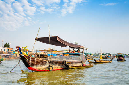 Trading boats on Cai Be Floating Market, Mekong Delta, Tien Giang, Vietnam