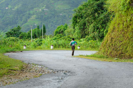 ha giang: Ethnic man walking on road, Ha Giang Province, Vietnam