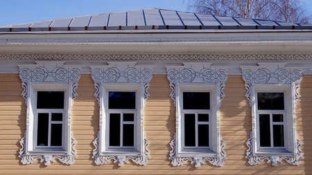 A wooden house in a small town with a russian thread