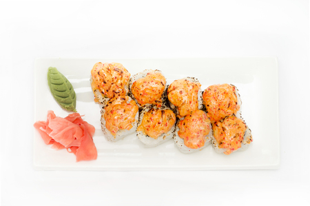 menu land: sushi roll platted on a white plate