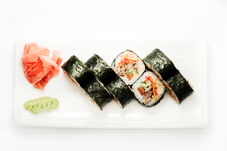 Sushi with tuna wrapped in nori on a white plate