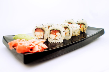 menu land: sushi roll platted on a black plate Stock Photo