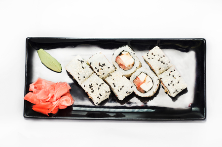 the land of menu: sushi roll platted on a black plate. Stock Photo