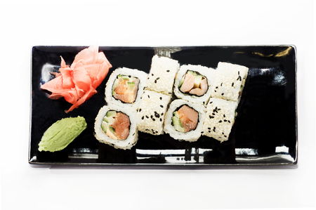 sushi roll platted on a black plate. Stock Photo