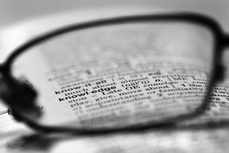 spectacle: A shot of the word knowledge through a spectacle lens.