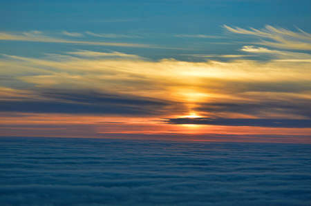Colorful midnight sun sunset from Nordkapp, Norway, with spectacular sky and sea fog