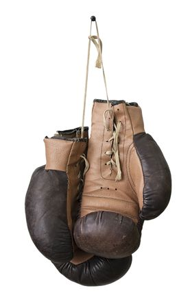 Old boxing gloves hanging on a lace Stock Photo - 6538656