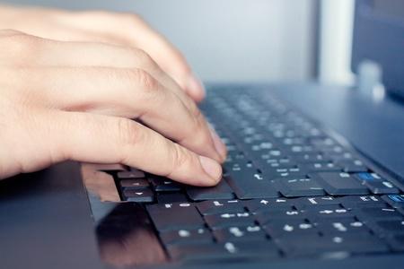 Hand over keyboard photo