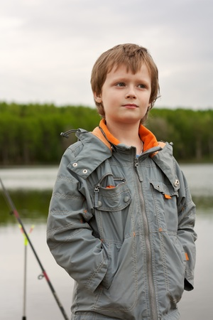 The little boy fishes. photo