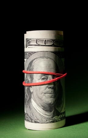 tightened: Tightened 100 dollar roll.