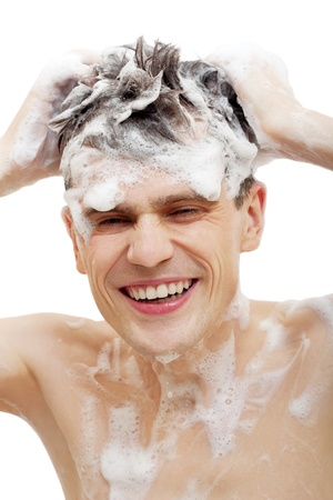Naked man with shampoo over hair in shower isolated on white background.