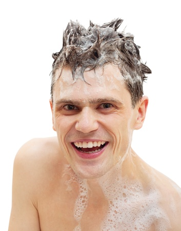 Naked man with shampoo over hair in shower isolated on white background. photo