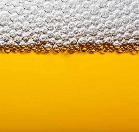 single beer bottle: Closeup beer with foam. Macro.