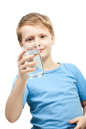 Little boy hold glass of water.