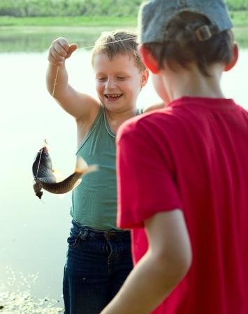 Молодой рыбак. Первая рыба.