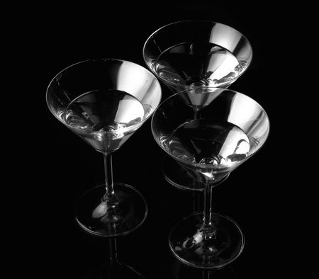 Silhouette of Three martini glass. Black and white graphic. Vintage photo. Фото со стока