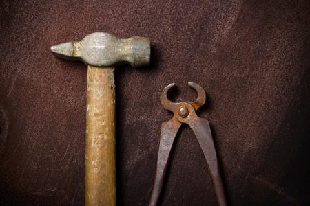 Old vintage clip with hammer on the grunge rusty background with copy-space Stock Photo - 10465541