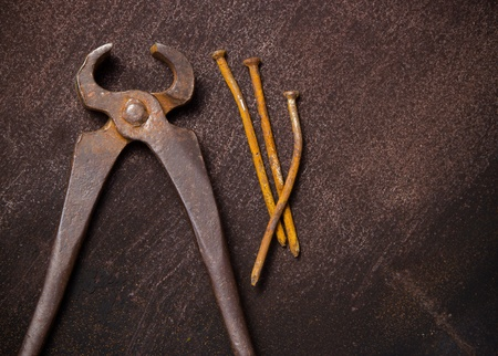 Old vintage clip with nails on the grunge rusty background with copy-space Stock Photo - 10465537
