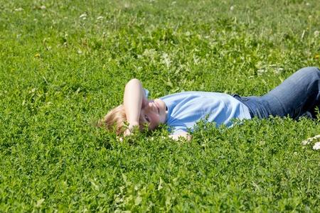 Boy have fun in green grass. photo