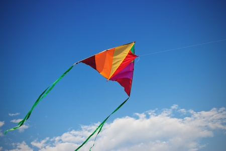Kite in the blue sky. Фото со стока