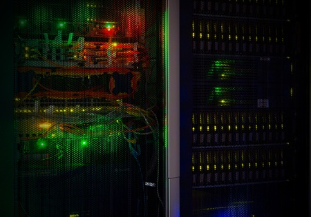Data center in the night. Dark room with light from telecommunication lights. Stock Photo