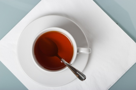 A cup of tea on a napkin  The geometric composition with copy space