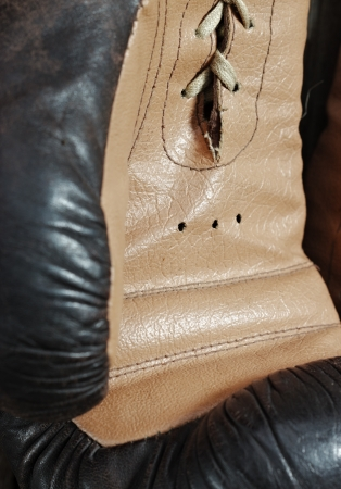 Brown old boxing gloves photo
