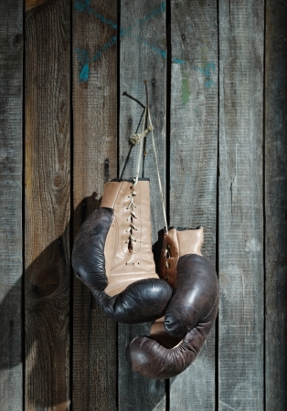 Brown old boxing gloves wooden wall photo