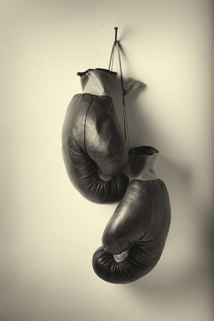 Vintage old boxing gloves photo