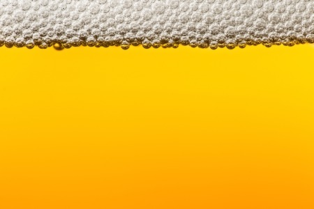 foam party: Beer with foam. Macro. Stock Photo