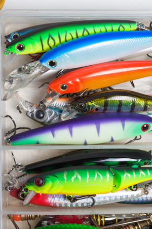 stocked: Closeup of a fishing box with colorful lures.