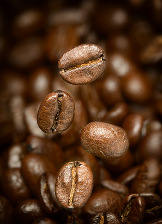 Macro photo of flying coffee beans. All beans in focus.