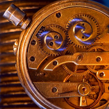 mechanism of older scratched, threadbared clock. Remake photo