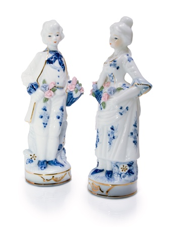 Two isolated porcelain figurines. Do not look at each other. photo