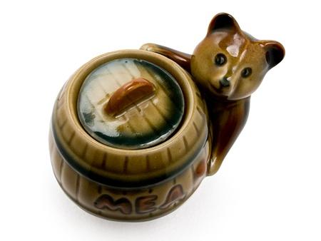 figurine of a bear with a barrel photo