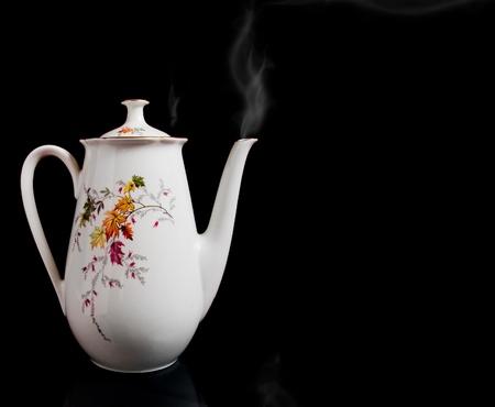 White big kettle  on black Stock Photo - 8720672