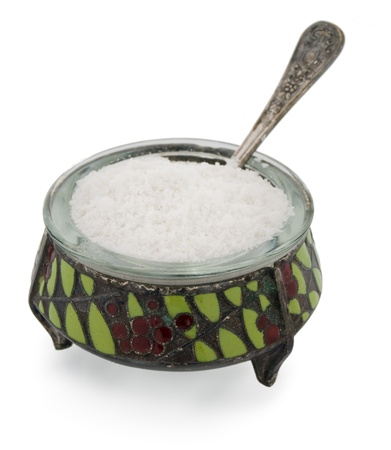 oxygenated: old salt container with spoon and salt Stock Photo