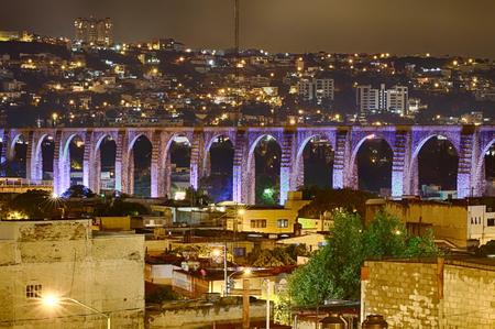A colonial bridge at night in Querétaro, Mexico