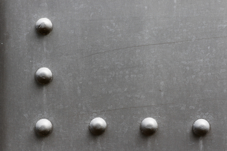 rivets: Grey metal with rivets texture